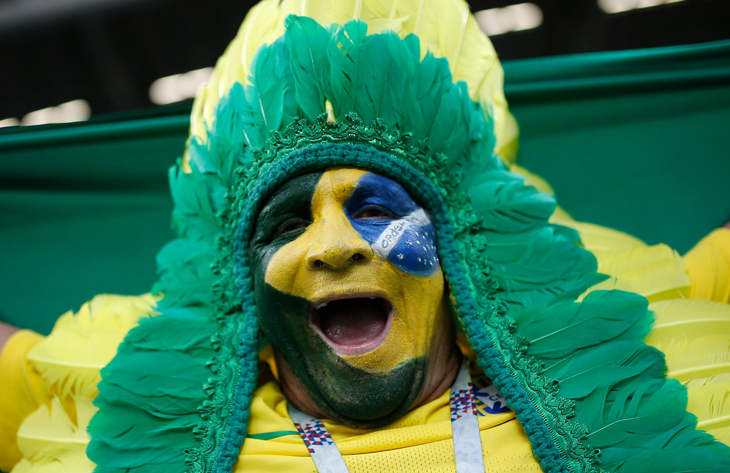 . A Brazil fan cheers prior to the quarterfinal match between Brazil and Belgium at the 2018 soccer World Cup in the Kazan Arena, in Kazan, Russia, Friday, July 6, 2018. (AP Photo/Francisco Seco)