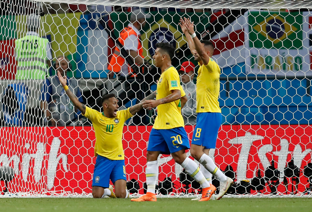 . Brazil\'s Neymar, left, Roberto Firmino, center and Renat Augusto complain during the quarterfinal match between Brazil and Belgium at the 2018 soccer World Cup in the Kazan Arena, in Kazan, Russia, Friday, July 6, 2018. (AP Photo/Eduardo Verdugo)