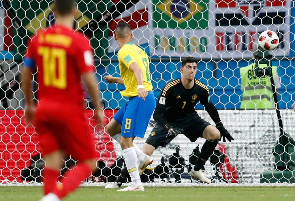 . Brazil\'s Renat Augusto (8) scores his side\'s opening goal during the quarterfinal match between Brazil and Belgium at the 2018 soccer World Cup in the Kazan Arena, in Kazan, Russia, Friday, July 6, 2018. (AP Photo/Eduardo Verdugo)