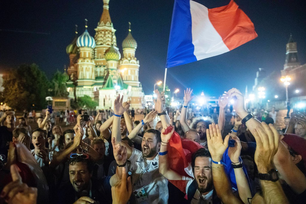 . France\'s soccer fans celebrate in Red square, with the St. Basil\'s Cathedral in the background, after their team won the final match between France and Croatia at the 2018 soccer World Cup in the Luzhniki Stadium in Moscow, Russia, Sunday, July 15, 2018. (AP Photo/Pavel Golovkin)