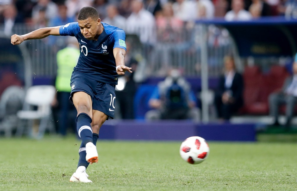 . France\'s Kylian Mbappe scores his side\'s fourth goal during the final match between France and Croatia at the 2018 soccer World Cup in the Luzhniki Stadium in Moscow, Russia, Sunday, July 15, 2018. (AP Photo/Petr David Josek)