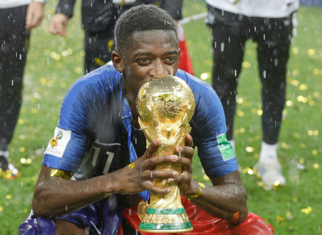 . France\'s Ousmane Dembele kisses the trophy at the end of the final match between France and Croatia at the 2018 soccer World Cup in the Luzhniki Stadium in Moscow, Russia, Sunday, July 15, 2018. (AP Photo/Matthias Schrader)