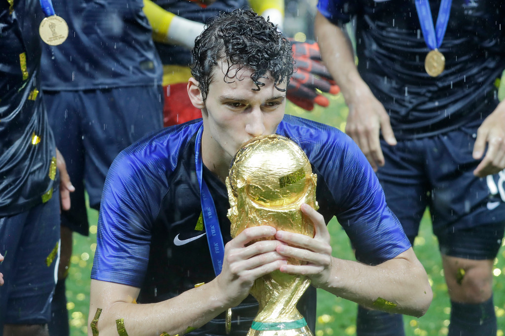 . France\'s Benjamin Pavard kisses the trophy at the end during the final match between France and Croatia at the 2018 soccer World Cup in the Luzhniki Stadium in Moscow, Russia, Sunday, July 15, 2018. (AP Photo/Matthias Schrader)