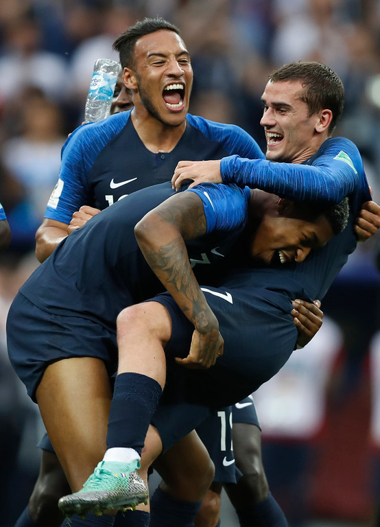 . France\'s Corentin Tolisso, at rear, France\'s Presnel Kimpembe, left celebrate with France\'s Antoine Griezmann after France defeated Croatia in the final match between France and Croatia at the 2018 soccer World Cup in the Luzhniki Stadium in Moscow, Russia, Sunday, July 15, 2018. France won the game 4-2. (AP Photo/Francisco Seco)