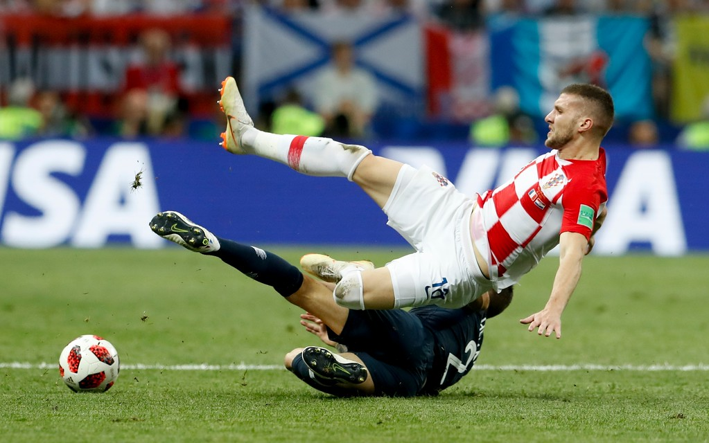 . France\'s Lucas Hernandez tackles Croatia\'s Ante Rebic during the final match between France and Croatia at the 2018 soccer World Cup in the Luzhniki Stadium in Moscow, Russia, Sunday, July 15, 2018. (AP Photo/Petr David Josek)