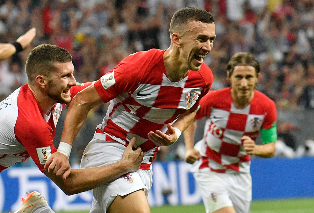 . Croatia\'s Ivan Perisic, center, celebrates after scoring his side\'s opening goal during the final match between France and Croatia at the 2018 soccer World Cup in the Luzhniki Stadium in Moscow, Russia, Sunday, July 15, 2018. (AP Photo/Martin Meissner)