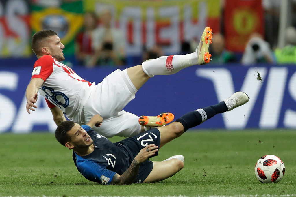 . Croatia\'s Ante Rebic, up, and France\'s Lucas Hernandez vie for the ball during the final match between France and Croatia at the 2018 soccer World Cup in the Luzhniki Stadium in Moscow, Russia, Sunday, July 15, 2018. (AP Photo/Natacha Pisarenko)
