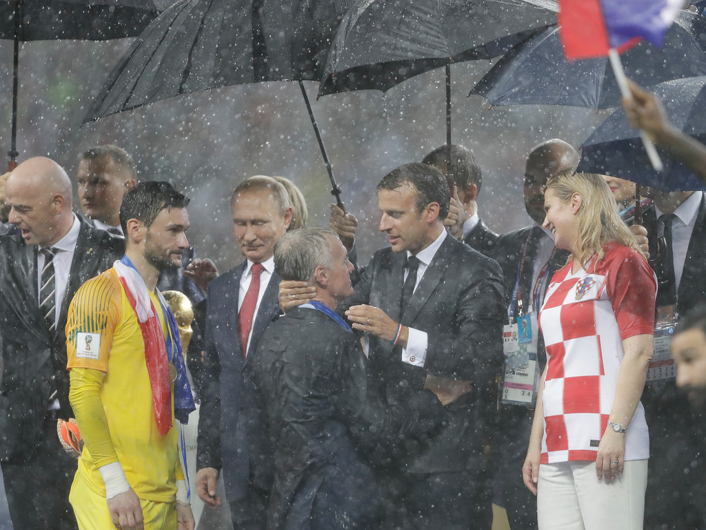 . France\'s President Emmanuel Macron embraces France head coach Didier Deschamps during the award ceremony after the final match between France and Croatia at the 2018 soccer World Cup in the Luzhniki Stadium in Moscow, Russia, Sunday, July 15, 2018. (AP Photo/Natacha Pisarenko)