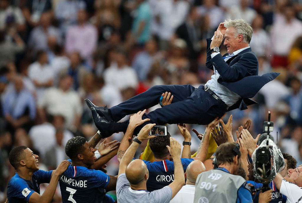 . France head coach Didier Deschamps is thrown into the air by his players as they celibate after defeating Croatian in the match between France and Croatia at the 2018 soccer World Cup in the Luzhniki Stadium in Moscow, Russia, Sunday, July 15, 2018. France won the game 4-2. (AP Photo/Francisco Seco)