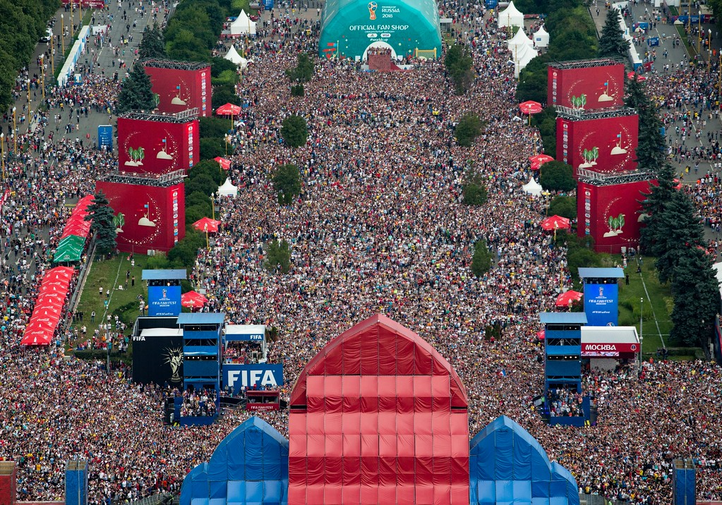 . Soccer fans celebrate in the fan zone after the final match between France and Croatia at the 2018 soccer World Cup in Moscow, Russia, Sunday, July 15, 2018. France fans did justice to their team\'s 4-2 victory over Croatia in the World Cup final on Sunday, pouring into Paris\' Champs-Elysees Avenue by the tens of thousands to celebrate with cheers, stomping and song in an explosion of joy mimicked in cities around the nation. (AP Photo/Alexander Zemlianichenko)