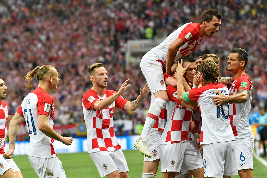. Croatian players celebrate after Croatia\'s Ivan Perisic scored his side\'s opening goal during the final match between France and Croatia at the 2018 soccer World Cup in the Luzhniki Stadium in Moscow, Russia, Sunday, July 15, 2018. (AP Photo/Martin Meissner)