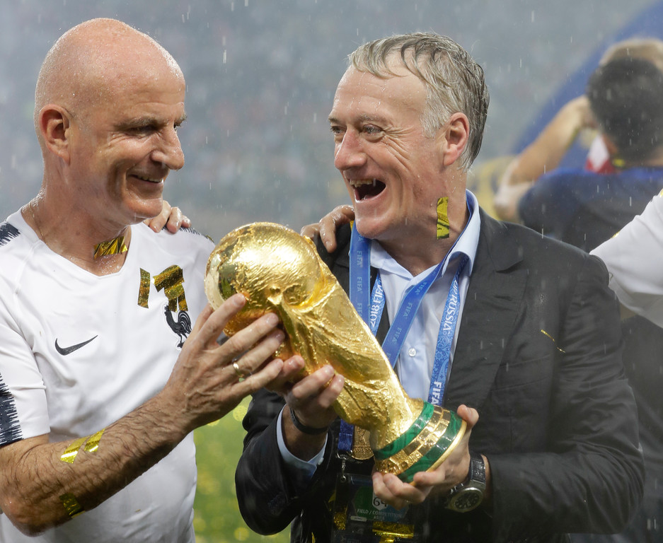 . France head coach Didier Deschamps, right, holds the trophy at the end of the final match between France and Croatia at the 2018 soccer World Cup in the Luzhniki Stadium in Moscow, Russia, Sunday, July 15, 2018. (AP Photo/Matthias Schrader)