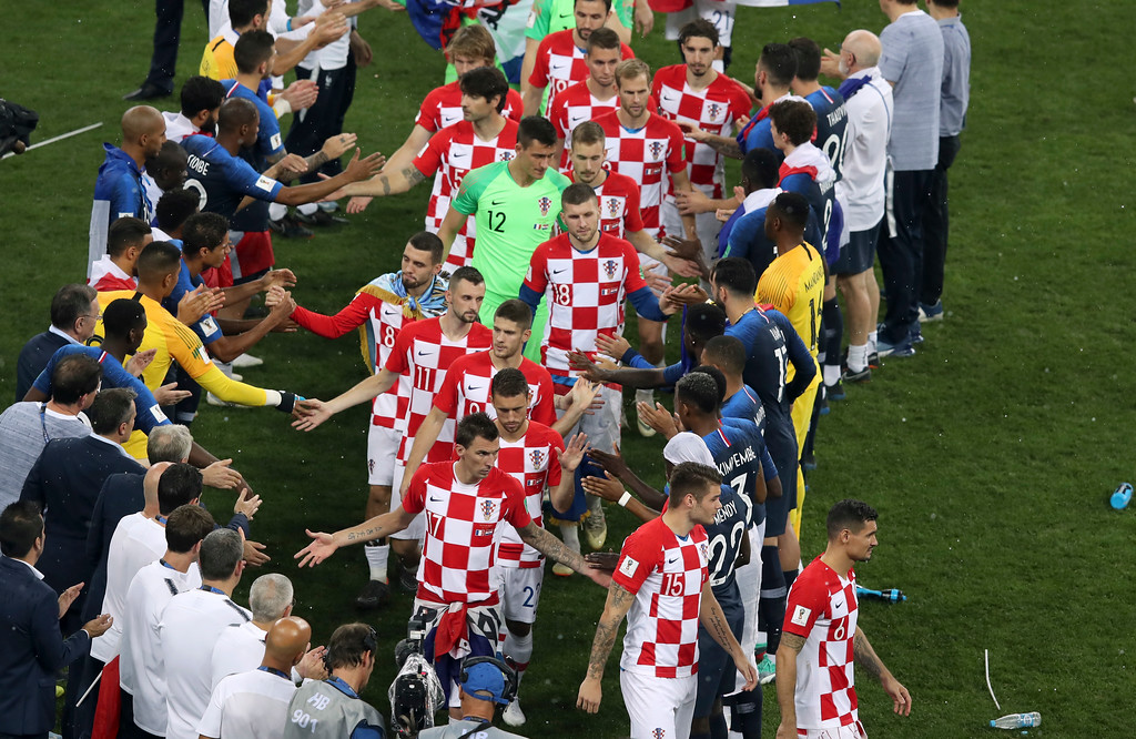 . Croatian players, center, shake hands with the French players at the end of the final match between France and Croatia at the 2018 soccer World Cup in the Luzhniki Stadium in Moscow, Russia, Sunday, July 15, 2018. (AP Photo/Thanassis Stavrakis)
