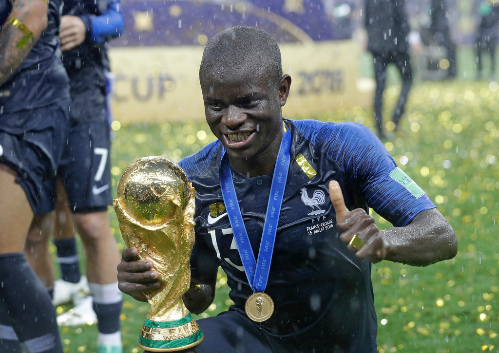 . France\'s Ngolo Kante celebrates with the trophy after the final match between France and Croatia at the 2018 soccer World Cup in the Luzhniki Stadium in Moscow, Russia, Sunday, July 15, 2018. France won the final 4-2. (AP Photo/Matthias Schrader)
