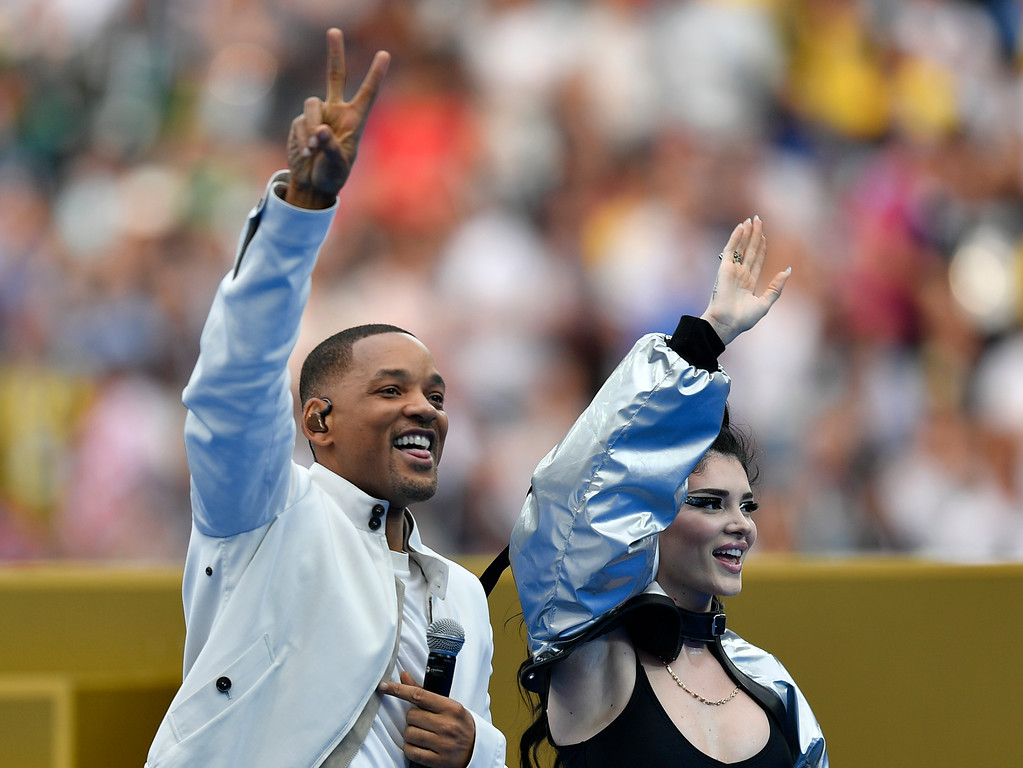 . Will Smith and Era Istrefi, right, perform prior to the final match between France and Croatia at the 2018 soccer World Cup in the Luzhniki Stadium in Moscow, Russia, Sunday, July 15, 2018. (AP Photo/Martin Meissner)
