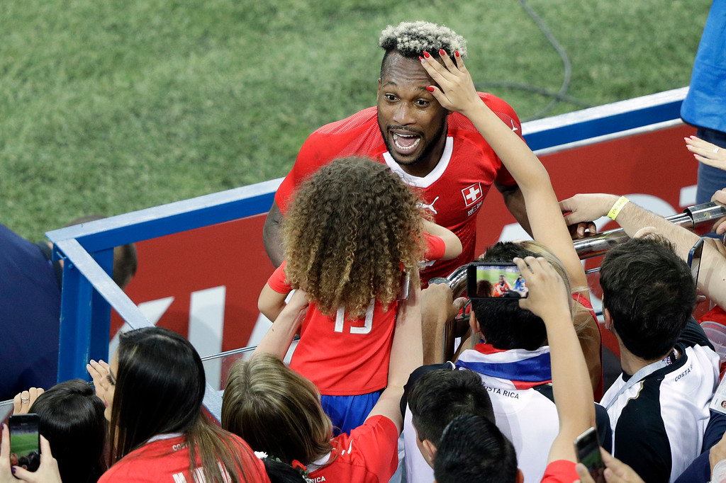 . Costa Rica\'s Kendall Waston meets family and friends at the end of the group E match between Switzerland and Costa Rica, at the 2018 soccer World Cup in the Nizhny Novgorod Stadium in Nizhny Novgorod , Russia, Wednesday, June 27, 2018. (AP Photo/Mark Baker)