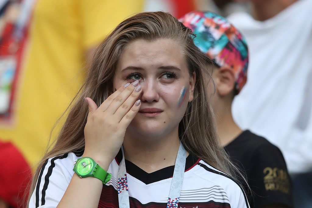 . A german fan wipes tears from her yes at the end of the group F match between South Korea and Germany, at the 2018 soccer World Cup in the Kazan Arena in Kazan, Russia, Wednesday, June 27, 2018. South Korea won 2-0. (AP Photo/Thanassis Stavrakis)
