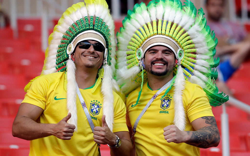 . Brazil supporters pose as they wait for the beginning of the group E match between Serbia and Brazil, at the 2018 soccer World Cup in the Spartak Stadium in Moscow, Russia, Wednesday, June 27, 2018. (AP Photo/Andre Penner)