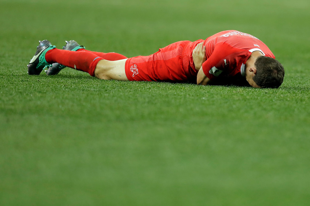 . Switzerland\'s Stephan Lichtsteiner lies on the ground during the group E match between Switzerland and Costa Rica, at the 2018 soccer World Cup in the Nizhny Novgorod Stadium in Nizhny Novgorod , Russia, Wednesday, June 27, 2018. (AP Photo/Natasha Pisarenko)
