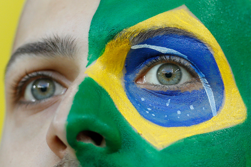 . Brazil\'s supporter colored the face with the national flag waits for the start of the group E match between Serbia and Brazil, at the 2018 soccer World Cup in the Spartak Stadium in Moscow, Russia, Wednesday, June 27, 2018. (AP Photo/Victor R. Caivano)