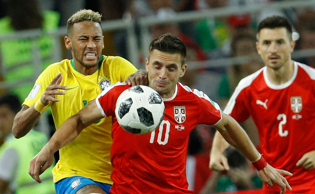 . Brazil\'s Neymar, left, Serbia\'s Dusan Tadic, center, and Antonio Rukavina challenge for the ball during the group E match between Serbia and Brazil, at the 2018 soccer World Cup in the Spartak Stadium in Moscow, Russia, Wednesday, June 27, 2018. (AP Photo/Victor R. Caivano)