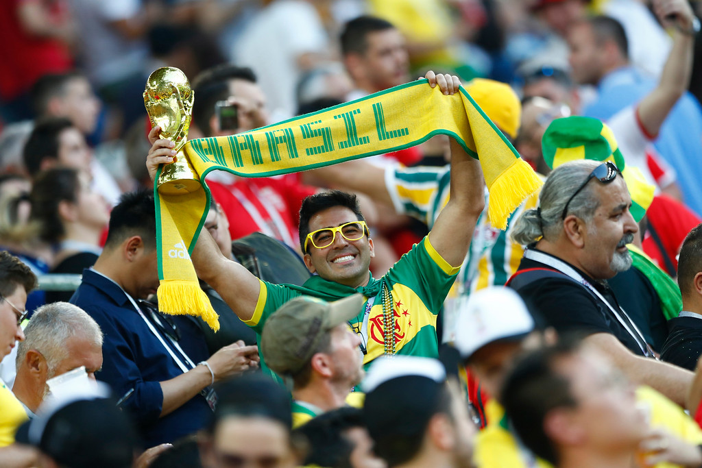 . A Brazil fan holds a copy of the World Cup trophy prior to the group E match between Serbia and Brazil, at the 2018 soccer World Cup in the Spartak Stadium in Moscow, Russia, Wednesday, June 27, 2018. (AP Photo/Matthias Schrader)