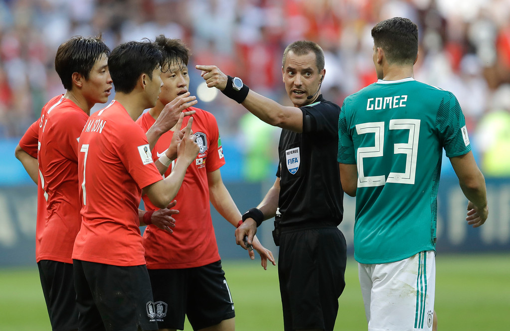 . Referee Mark Geiger from the US gestures before the VAR decision on the Korea goal during the group F match between South Korea and Germany, at the 2018 soccer World Cup in the Kazan Arena in Kazan, Russia, Wednesday, June 27, 2018. (AP Photo/Michael Probst)