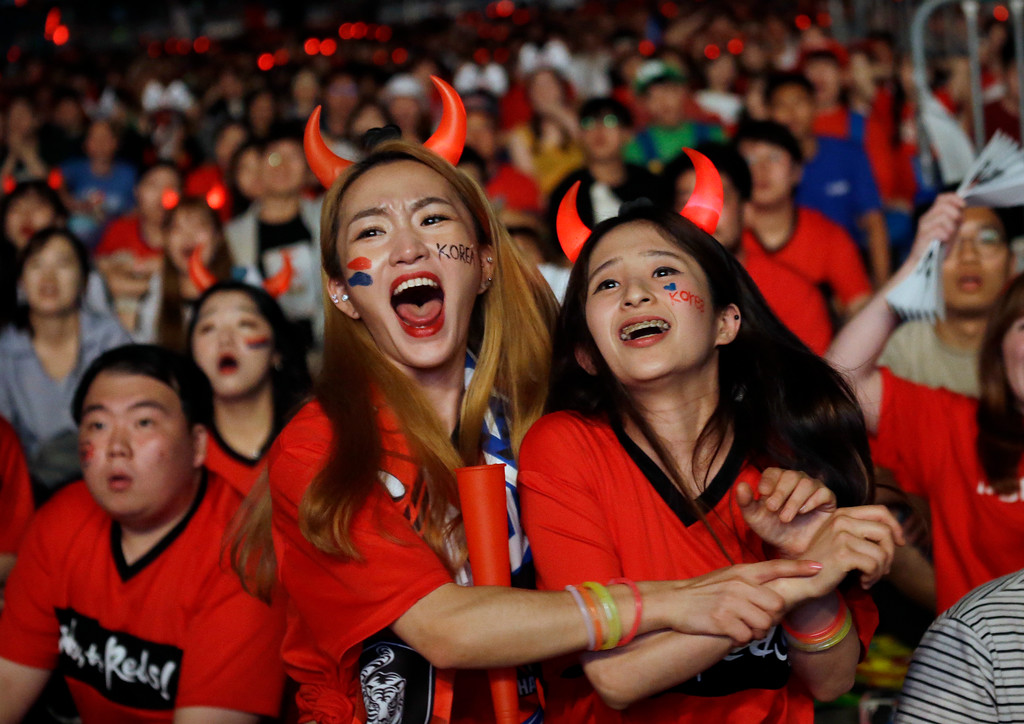. South Korean soccer fans celebrate as they watch a live broadcasting of the Group F World Cup soccer match between South Korea and Germany, at a public viewing venue in Seoul, South Korea, Thursday, June 28, 2018. (AP Photo/Ahn Young-joon)