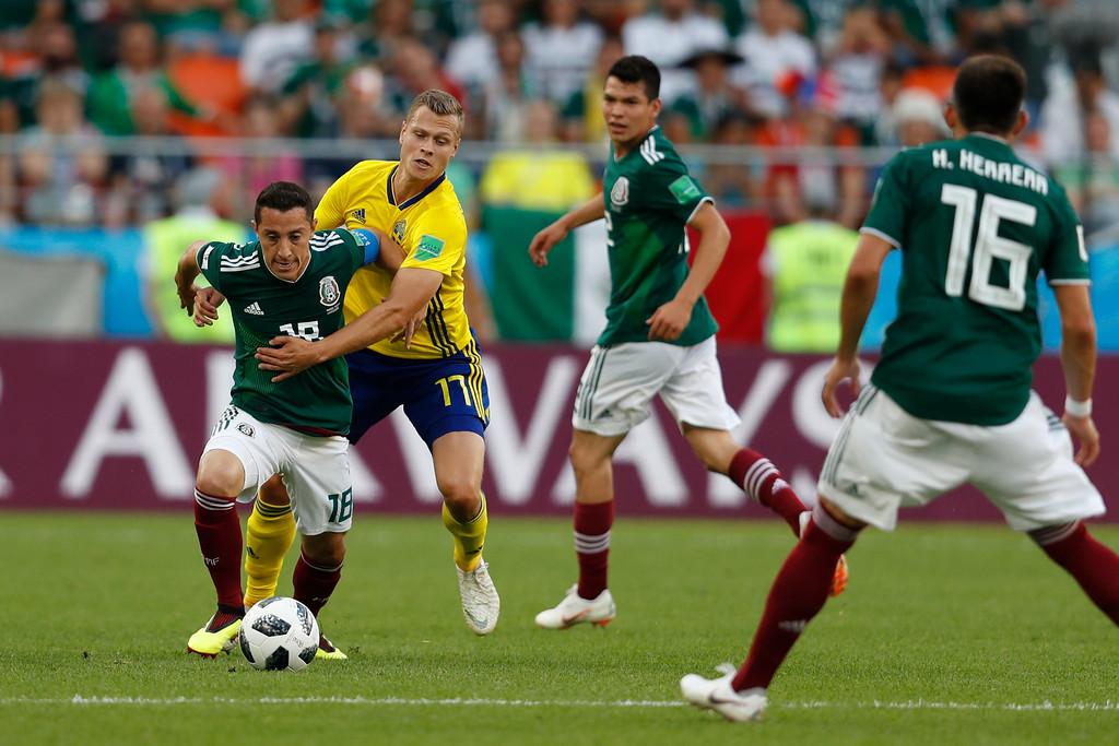 . Mexico\'s Andres Guardado, left, and Sweden\'s Viktor Claesson, second from left, challenge for the ball during the group F match between Mexico and Sweden, at the 2018 soccer World Cup in the Yekaterinburg Arena in Yekaterinburg, Russia, Wednesday, June 27, 2018. (AP Photo/Eduardo Verdugo)