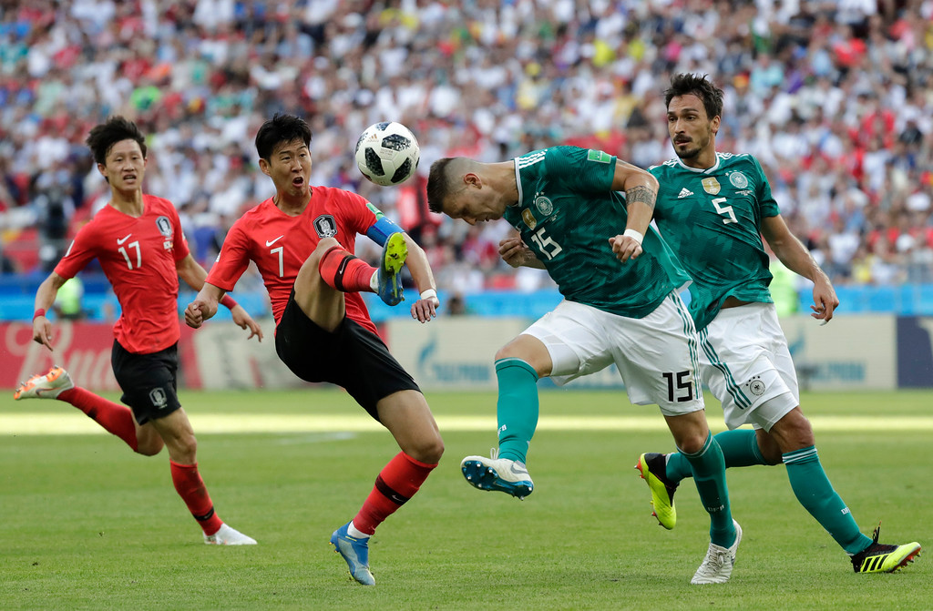 . South Korea\'s Son Heung-min, 2nd left, challenges for the ball Germany\'s Niklas Suele, 2nd right, during the group F match between South Korea and Germany, at the 2018 soccer World Cup in the Kazan Arena in Kazan, Russia, Wednesday, June 27, 2018. (AP Photo/Lee Jin-man)