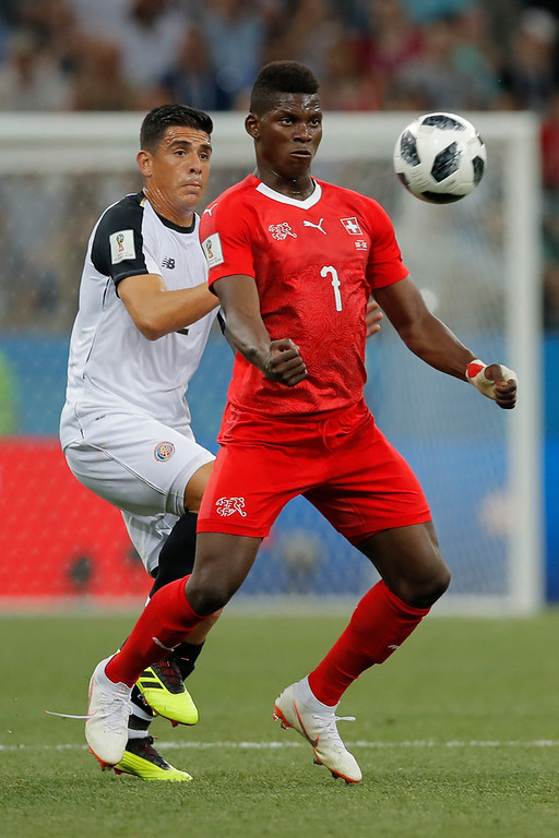 . Switzerland\'s Breel Embolo, right, and Costa Rica\'s Johnny Acosta fight for the ball during the group E match between Switzerland and Costa Rica at the 2018 soccer World Cup in the Nizhny Novgorod Stadium in Nizhny Novgorod, Russia, Wednesday, June 27, 2018. (AP Photo/Vadim Ghirda)