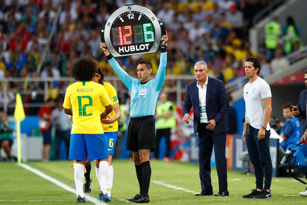 . Brazil head coach Tite, right, gives instructions from the side line as Brazil\'s Marcelo, left, leaves the pitch as he is substituted during the group E match between Serbia and Brazil, at the 2018 soccer World Cup in the Spartak Stadium in Moscow, Russia, Wednesday, June 27, 2018. (AP Photo/Matthias Schrader)