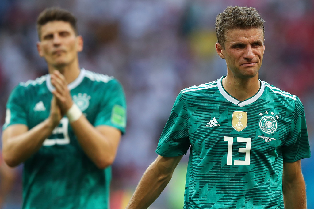. Germany\'s Thomas Mueller, right, and Mario Gomez walk on the pitch at the end of the group F match between South Korea and Germany, at the 2018 soccer World Cup in the Kazan Arena in Kazan, Russia, Wednesday, June 27, 2018. Defending champion Germany has been eliminated in the group stage of the World Cup in a 2-0 stoppage-time loss to South Korea and Sweden has topped Group F with a 3-0 win over Mexico. (AP Photo/Thanassis Stavrakis)