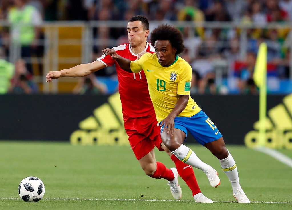 . Brazil\'s Willian, right, is challenged by Serbia\'s Filip Kostic during the group E match between Serbia and Brazil, at the 2018 soccer World Cup in the Spartak Stadium in Moscow, Russia, Wednesday, June 27, 2018. (AP Photo/Rebecca Blackwell)