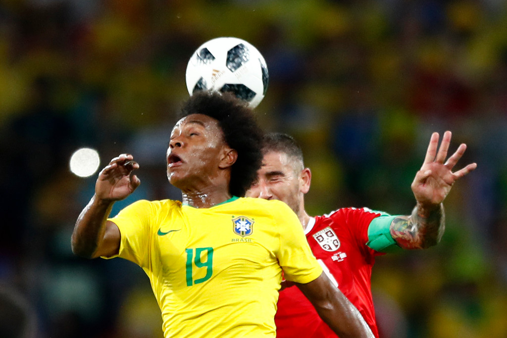 . Brazil\'s Willian, left, and Serbia\'s Aleksandar Kolarov jump for the ball during the group E match between Serbia and Brazil, at the 2018 soccer World Cup in the Spartak Stadium in Moscow, Russia, Wednesday, June 27, 2018. (AP Photo/Matthias Schrader)