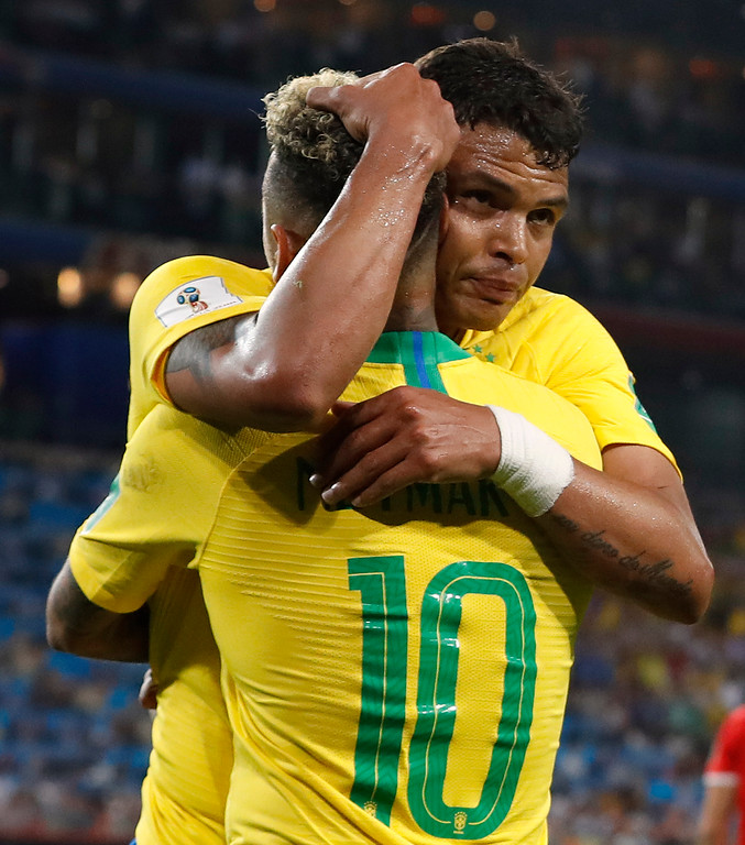 . Brazil\'s Thiago Silva, face to camera, celebrates with teammate Neymar after scoring his side\'s second goal during the group E match between Serbia and Brazil, at the 2018 soccer World Cup in the Spartak Stadium in Moscow, Russia, Wednesday, June 27, 2018. (AP Photo/Rebecca Blackwell)