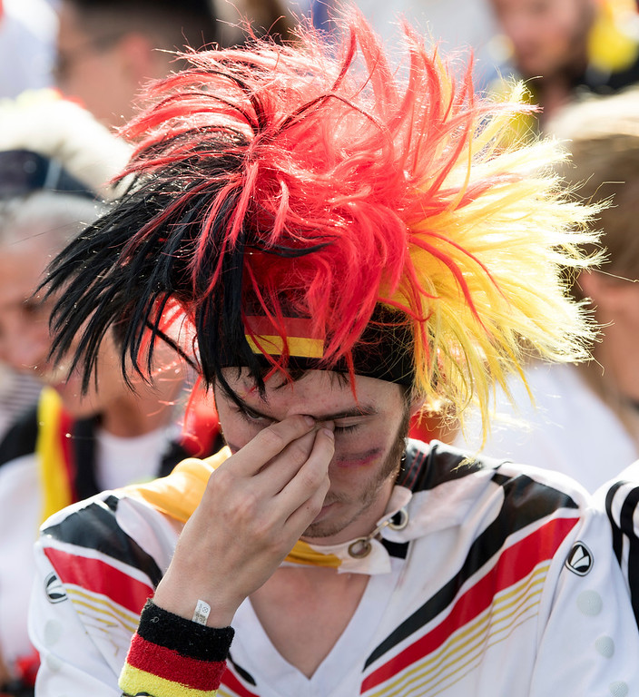 . Soccer fans react after Germany was eliminated from the World Cup as they watch the group F World Cup match between South Korea and Germany as they visit the fan mile in Berlin Wednesday, June 27, 2018. (Bernd von Jutrczenka/dpa via AP)