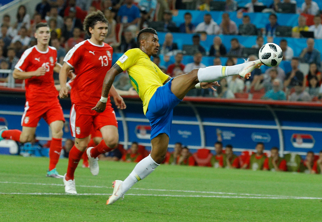 . Brazil\'s Paulinho, center, scores their team\'s first goal during the group E match between Serbia and Brazil, at the 2018 soccer World Cup in the Spartak Stadium in Moscow, Russia, Wednesday, June 27, 2018. (AP Photo/Victor R. Caivano)