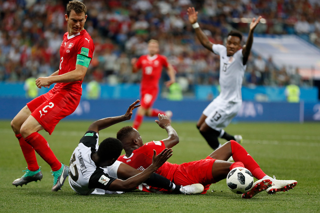 . Costa Rica\'s Joel Campbell, second from left, is fouled by Switzerland\'s Denis Zakaria to give Costa Rica a penalty kick during the group E match between Switzerland and Costa Rica, at the 2018 soccer World Cup in the Nizhny Novgorod Stadium in Nizhny Novgorod , Russia, Wednesday, June 27, 2018. (AP Photo/Natasha Pisarenko)
