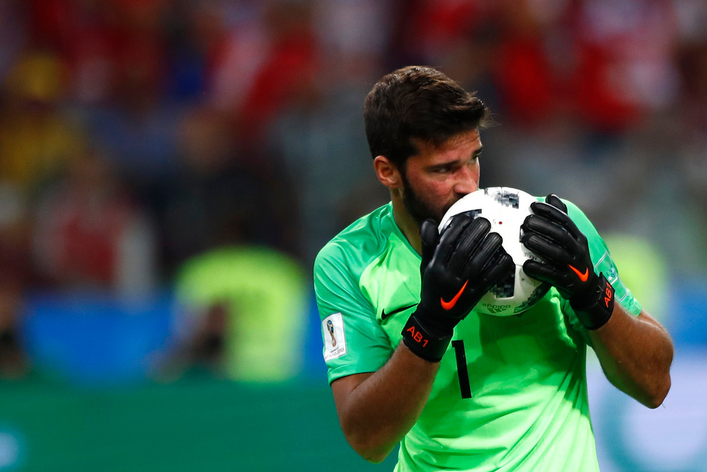 . Brazil goalkeeper Alisson kisses the ball after makes a save during the group E match between Serbia and Brazil, at the 2018 soccer World Cup in the Spartak Stadium in Moscow, Russia, Wednesday, June 27, 2018. (AP Photo/Matthias Schrader)