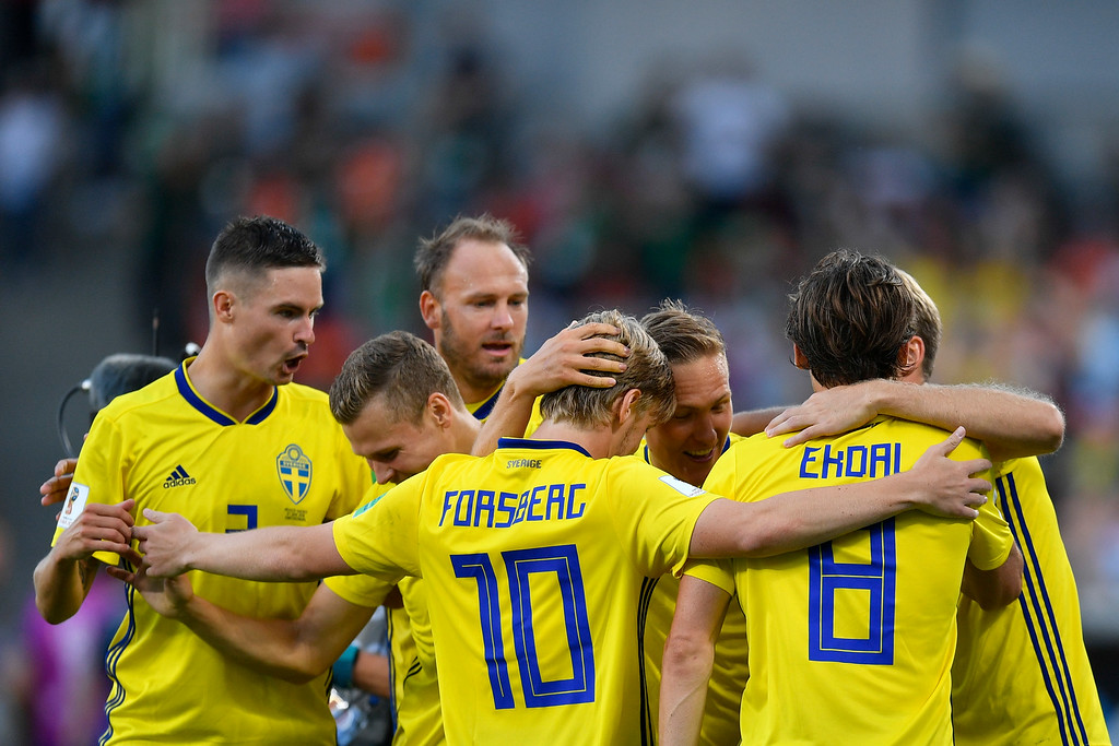 . Sweden players celebrate after Ludwig Augustinsson scored their side\'s opening goal during the group F match between Mexico and Sweden, at the 2018 soccer World Cup in the Yekaterinburg Arena in Yekaterinburg , Russia, Wednesday, June 27, 2018. (AP Photo/Martin Meissner)