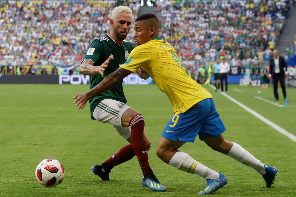 . Brazil\'s Gabriel Jesus, right, vies for the ball with Mexico\'s Miguel Layun, left, during the round of 16 match between Brazil and Mexico at the 2018 soccer World Cup in the Samara Arena, in Samara, Russia, Monday, July 2, 2018. (AP Photo/Andre Penner)