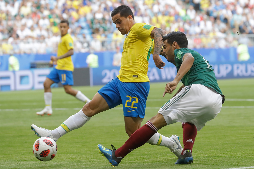 . Brazil\'s Fagner, left, vies for the ball with Mexico\'s Carlos Vela, right, during the round of 16 match between Brazil and Mexico at the 2018 soccer World Cup in the Samara Arena, in Samara, Russia, Monday, July 2, 2018. (AP Photo/Andre Penner)