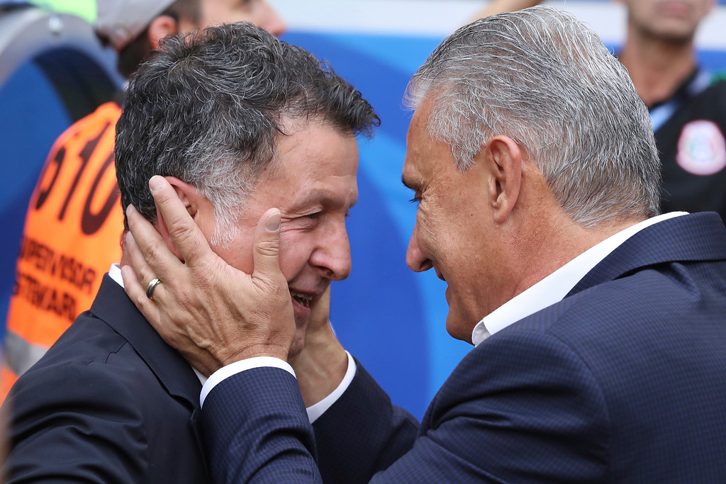 . Brazil head coach Tite, right, greets Mexico head coach Juan Carlos Osorio prior the round of 16 match between Brazil and Mexico at the 2018 soccer World Cup in the Samara Arena, in Samara, Russia, Monday, July 2, 2018. (AP Photo/Thanassis Stavrakis)
