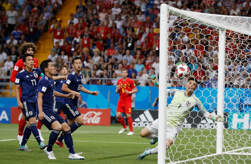 . Japan goalkeeper Eiji Kawashima, right, fails to save a ball as Belgium\'s Jan Vertonghen, center, scores his first side\'s goal during the round of 16 match between Belgium and Japan at the 2018 soccer World Cup in the Rostov Arena, in Rostov-on-Don, Russia, Monday, July 2, 2018. (AP Photo/Rebecca Blackwell)