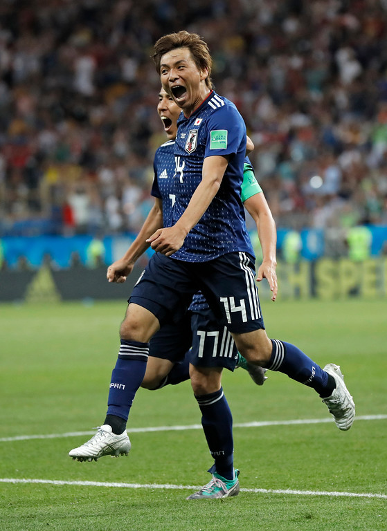 . Japan\'s Takashi Inui, center, celebrates after scoring his side\'s second goal during the round of 16 match between Belgium and Japan at the 2018 soccer World Cup in the Rostov Arena, in Rostov-on-Don, Russia, Monday, July 2, 2018. (AP Photo/Petr David Josek)