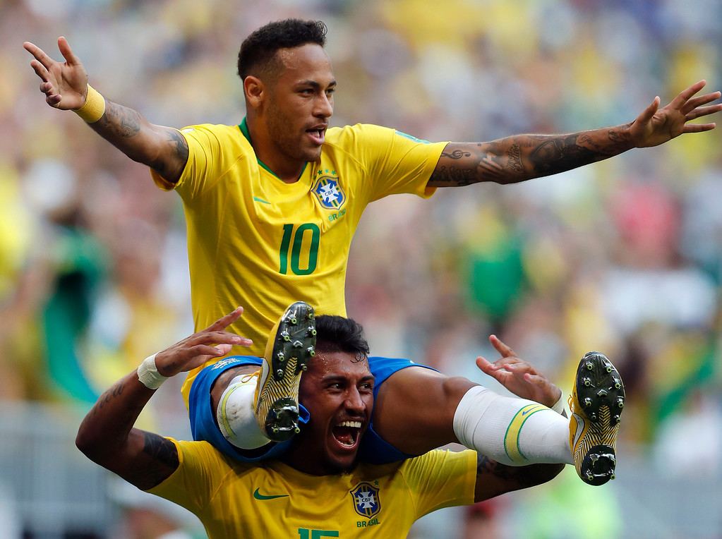 . Brazil\'s Neymar, top, celebrates with team mate Paulinho after scoring his side\'s opening goal during the round of 16 match between Brazil and Mexico at the 2018 soccer World Cup in the Samara Arena, in Samara, Russia, Monday, July 2, 2018. (AP Photo/Frank Augstein)