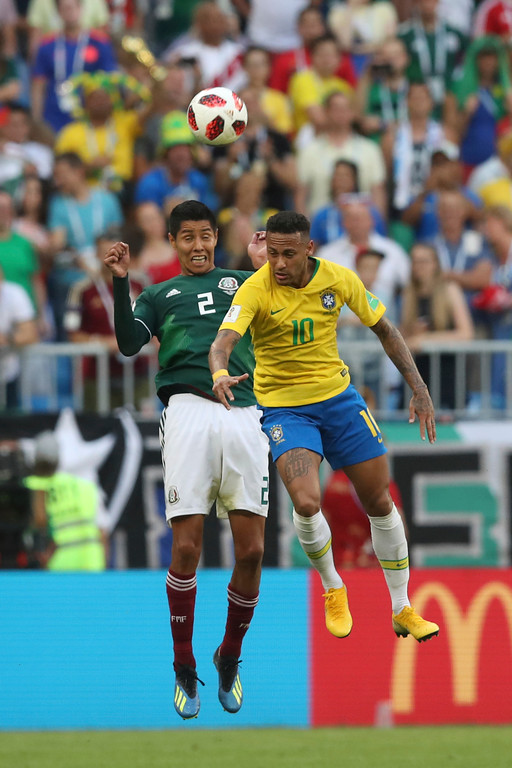 . Brazil\'s Neymar, right, goes for a header with Mexico\'s Hugo Ayala during the round of 16 match between Brazil and Mexico at the 2018 soccer World Cup in the Samara Arena, in Samara, Russia, Monday, July 2, 2018. Neymar scored once in Brazil\'s 2-0 victory. (AP Photo/Thanassis Stavrakis)