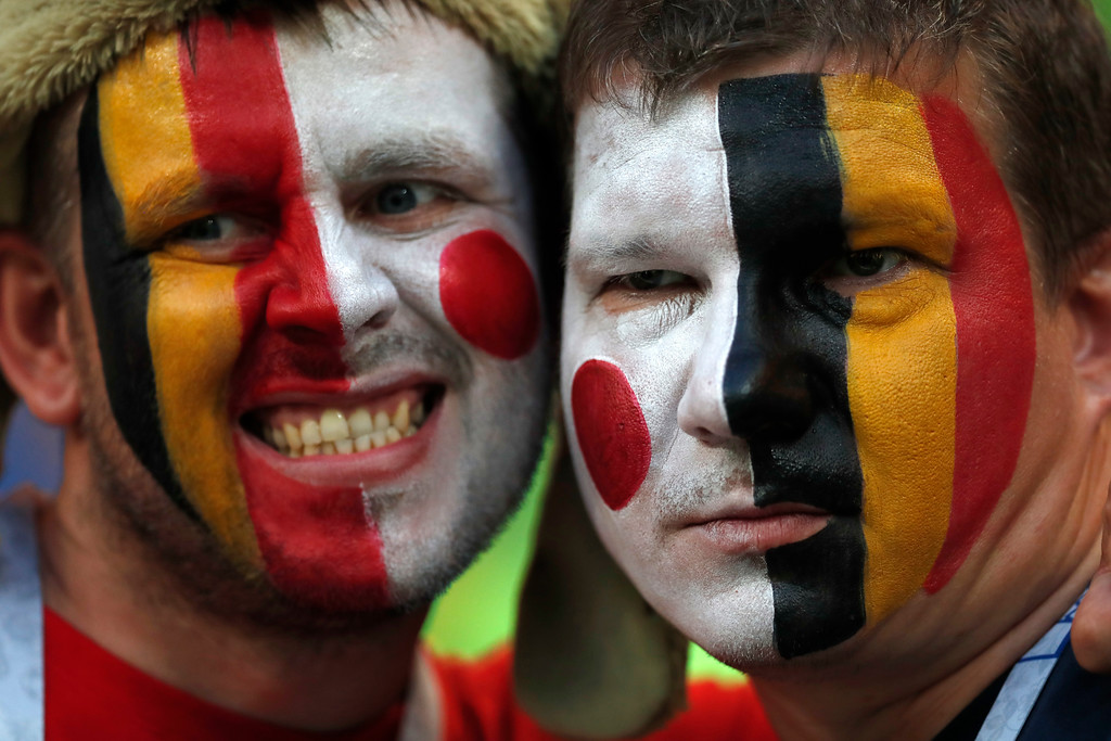 . Belgium fans wait for start the match prior of the round of 16 match between Belgium and Japan at the 2018 soccer World Cup in the Rostov Arena, in Rostov-on-Don, Russia, Monday, July 2, 2018. (AP Photo/Rebecca Blackwell)