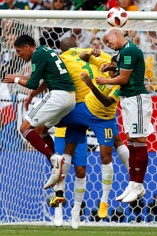 . Mexico\'s Carlos Salcedo heads the ball during the round of 16 match between Brazil and Mexico at the 2018 soccer World Cup in the Samara Arena, in Samara, Russia, Monday, July 2, 2018. (AP Photo/Eduardo Verdugo)